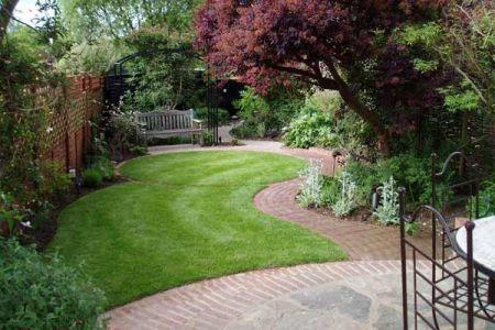 How-to-plant-a-small-garden-ideas-lawn-shrubs-wooden-bench-garden-paths